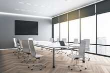 Big Blank Black Poster On Grey Wall In Modern Eco Style Meeting Room With Huge Windows, Dark Wooden Parquet And White Furniture. Mockup. 3D Rendering