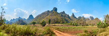 Panoramic View Of The Northern Thailand Mountains In Spring. Fields And Palmtrees In The Valley. Chiang Mai Province. Chiang Dao District