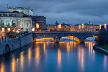 Arch Bridge Over River In City