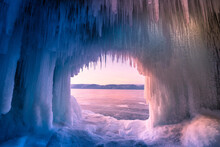 Inside The Blue Ice Cave With Couple Love At Lake Baikal, Siberia, Eastern Russia.