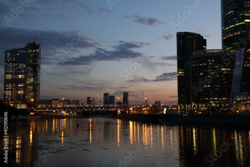 Urban landscape with a river in the night © Alexey Kuznetsov