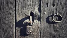 Closeup Shot Of An Old Wooden Door And A Padlock
