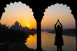 Leinwandbild Motiv Silhouette Of Woman Standing In The Dorm Opposite To Tajmahal
