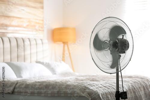 Obraz Modern electric fan in bedroom. Space for text - fototapety do salonu