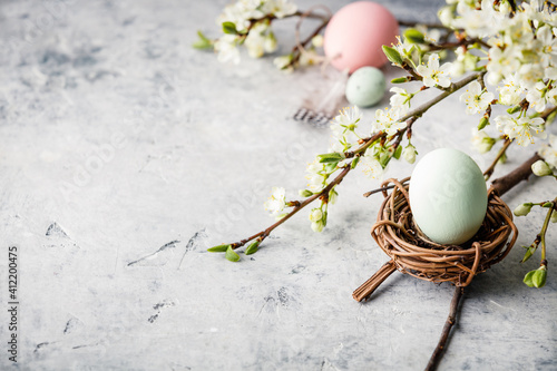 Fototapeta High Angle View Of Egg In Nest By Flowers On Marble