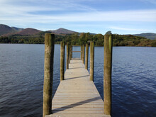 Wooden Pier On Lake Against Sky