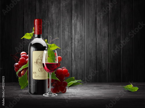 Obraz na plátně Bottle and a transparent glass of red wine and a branch of red grapes