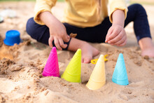 Different Colors Molds Ice Cream For Sand. On Background Little Cute Child Play With Sand. Enjoy And Play Outdoors In Summer. Great Vacation With Children.