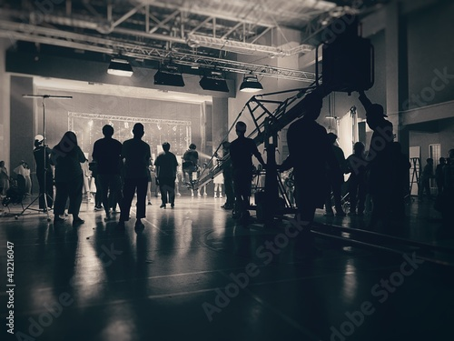 Behind the scenes of music video shooting production crew team silhouette and camera equipment in studio Fototapete