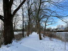 Snow On A Path Next To A Frozen Canal In Sneek
