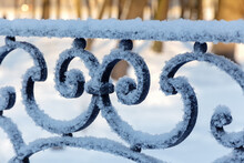 Cast Iron Fence Covered With Frost And Snow