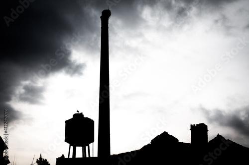 Fototapeta Old factory brick chimney with storck nest