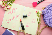 Notebook With Written Text HELLO SPRING And Female Accessories On Color Wooden Background