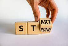 Start Strong Symbol. Businessman Turns Wooden Cubes With Words 'start Strong'. Beautiful White Background, Copy Space. Business And Start Strong Concept.