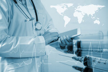 Digital Composite Image Of Doctor Using Digital Tablet By Syringes And World Map