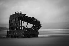 Shipwreck At Sea Against Sky