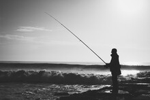 Fisherman On A Pier With Angry Sea Black And White