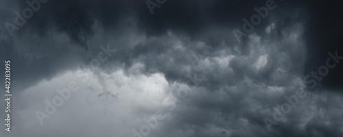 Fototapeta Background of dark stormy ominous clouds in gray moody sky obraz