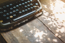 Old Typewriter On The Wood Table, Copy Space, Selective Focus.