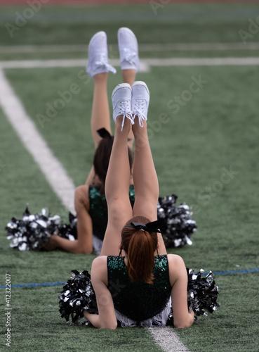 Obraz na plátně High school dancer performing at a football game halftime show