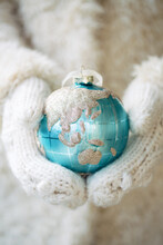 Hands Holding Christmas Ornament