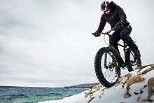 Extreme Sport Winter Mountain Bike Rider On Fat Bike In Snow