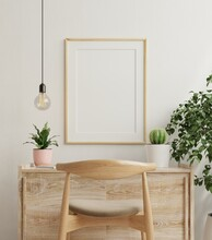 Mockup Frame On Work Table In Living Room Interior On Empty White Wall Background.