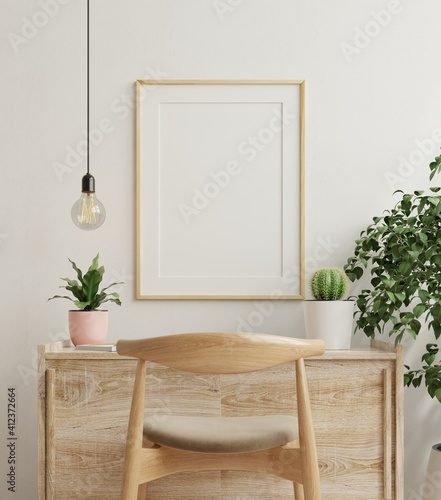 Obraz Mockup frame on work table in living room interior on empty white wall background. - fototapety do salonu