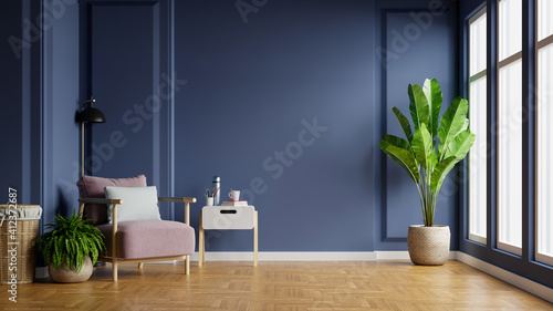 Obraz Interior of light room with armchair on empty dark blue wall background. - fototapety do salonu