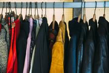 Old Coats On Wooden Hangers