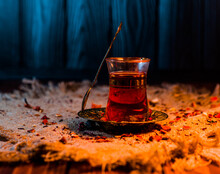 Turkish Tea With Oriental Spices And A Spoon In Warm Home Light