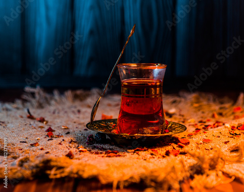 Canvas Print Turkish tea with oriental spices and a spoon in warm home light
