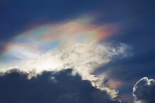 Fire Rainbow Above The Clouds In Blue Sky