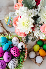 Hand Drawn & Colored Easter Eggs Next To Fresh Cut Flowers