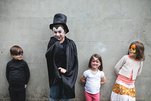 Young Children Waiting To Go Trick Or Treating At Halloween