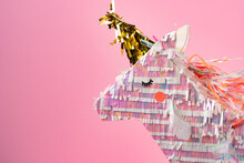 Unicorn Pinata For Kids Party On Pink Background