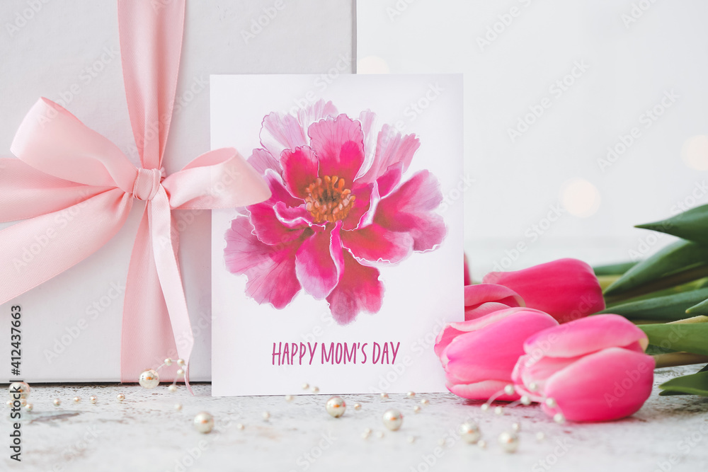 Fototapeta Beautiful flowers, gift and greeting card for Mother's Day on light background