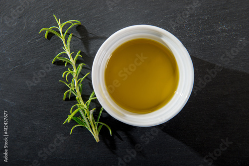 Fototapeta High Angle View Of Tea With Herbs On Table obraz