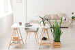 Modern work place in living room or studio, natural light, home plants