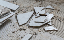 Concrete Wall And Floor, Construction Or Destruction Site With Remnants Of Tile Adhesive