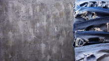Denim Jeans On Old Abstract Background Texture Of Table