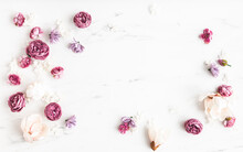 Flowers Composition. White And Purple Flowers On Marble Background. Flat Lay, Top View