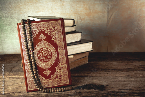 Koran - holy book of Muslims ( public item of all muslims ) on the table , still life Fototapet