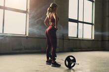 Sportswoman Preparing To Lift Barbell