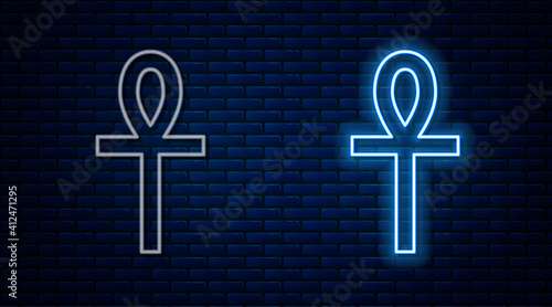 Fototapeta Glowing neon line Cross ankh icon isolated on brick wall background
