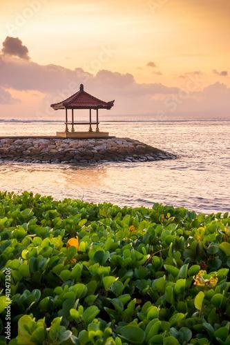 Fototapeta Gazebo On Pier By Sea Against Sky During Sunset