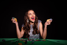 Photo Of Amazed Excited Young Lady Hold Poker Chips Sit Table Luck Winner Rich Money Isolated On Black Color Background