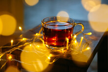 Cup Of Tea Surrounded By Fairy Lights On A Table