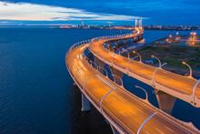 Saint Petersburg. Russia. Bridge Over The Gulf Of Finland. Bridge In The Night St. Petersburg. Road Architecture Of Russia. Bridge Over Kresmtovsky Island. Bridgework Meanders Around The Island.