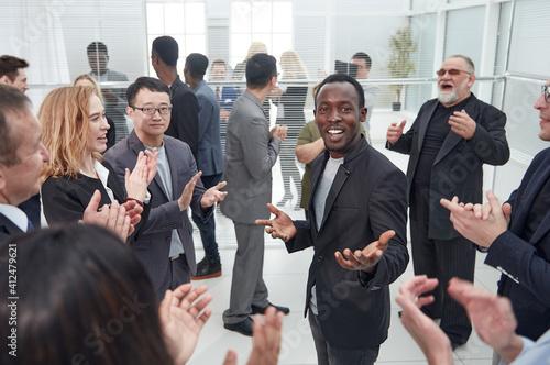 Fototapeta large international business team applauding the best employee . obraz